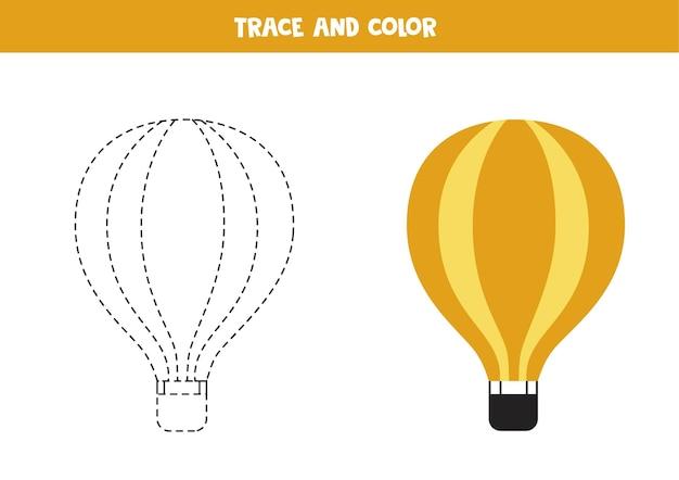 Traçar e colorir o balão de ar quente dos desenhos animados. jogo educativo para crianças. prática de escrita e coloração.