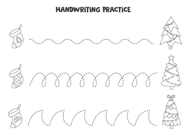 Traçar linhas para crianças com meias e árvores de natal em preto e branco. prática de caligrafia para crianças.