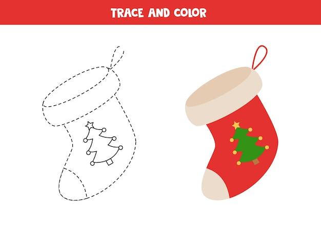 Trace e colore a meia de natal dos desenhos animados. planilha para crianças.