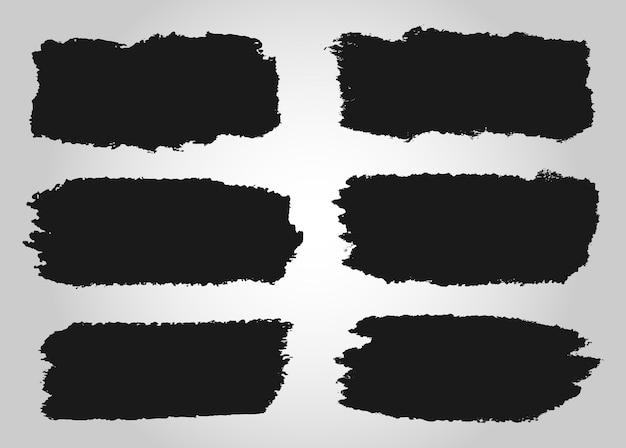 Traços abstratos de grunge preto Vetor Premium