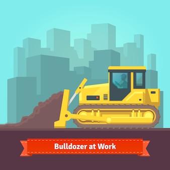 Tractor de escavadeira nivelando terra