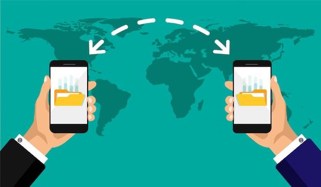 Transferência de arquivos em um plano de fundo do mapa. mãos segura o telefone com o upload de arquivos. design plano de transferência de documentos entre dois smartphones.
