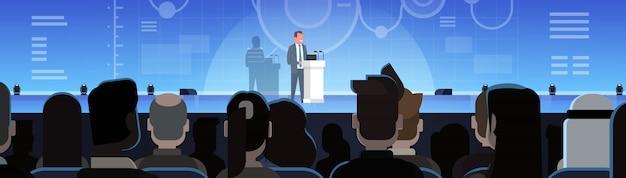 Treinamento de negócios ou coaching empresário levando apresentação na frente do grupo de empresários trai