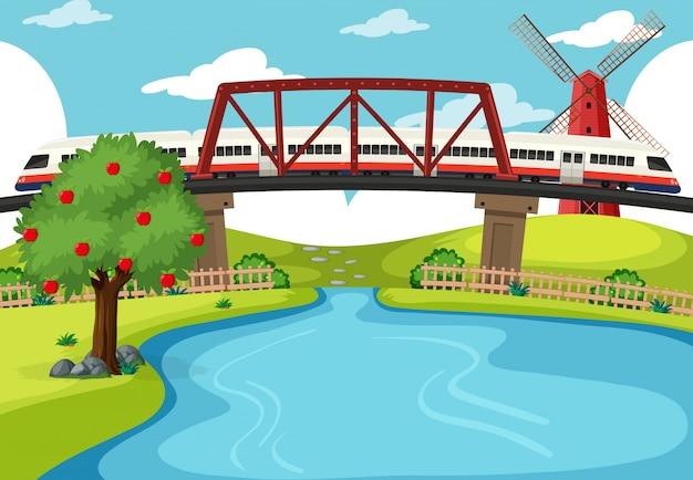 Trem atravessando a cena do rio