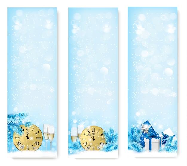 Três banners de natal com caixas de presente e floco de neve