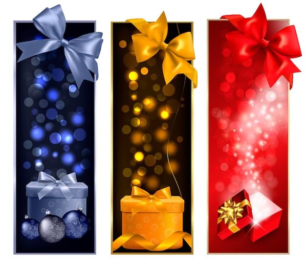 Três banners de natal com caixas de presente e flocos de neve