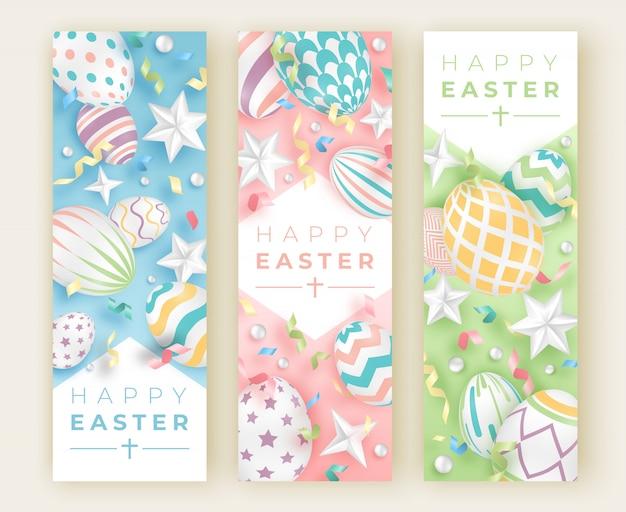 Três banners verticais de páscoa com ovos decorados realistas, fitas, estrelas e bolas