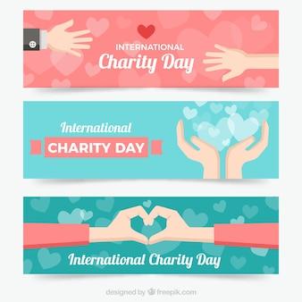 Três belas bandeiras com as mãos do dia da caridade