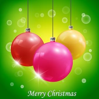 Três bolas coloridas realistas de decoração de natal em uma ilustração brilhante
