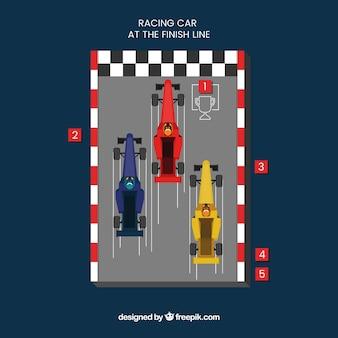 Três carros de corrida f1 cruzando a linha de chegada