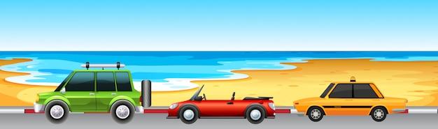 Três carros de estacionamento junto à praia