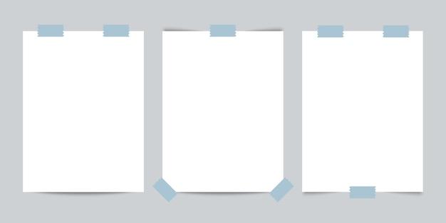 Três cartões de visita com fita adesiva em fundo cinza