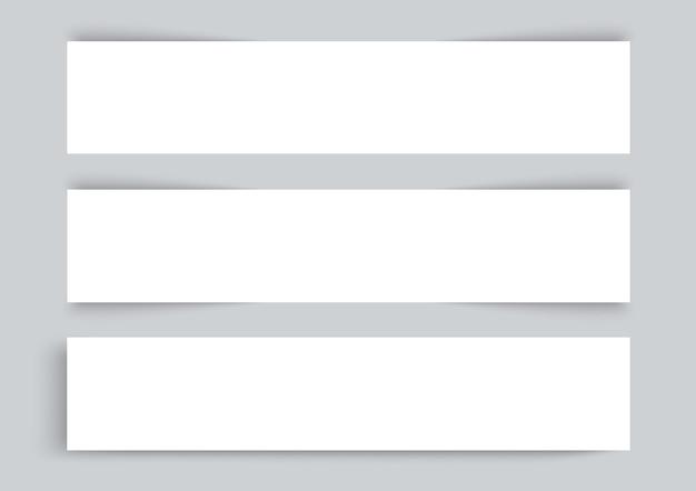 Três cartões de visita em fundo cinza