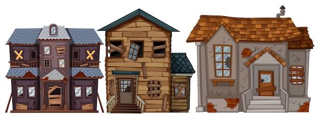Três casas antigas com janelas quebradas