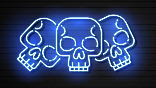 Três caveiras no estilo de efeito neon.