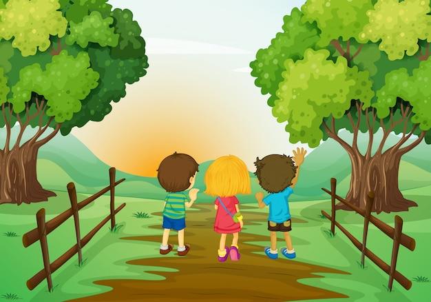 Três crianças, observar, a, pôr do sol
