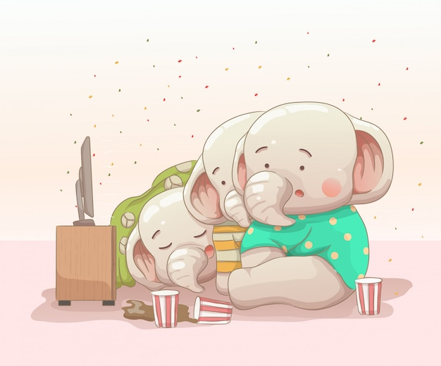 Três filhotes de elefante assistindo filme