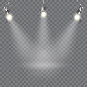 Três focos suspensos projetam com direção dos raios em um ponto