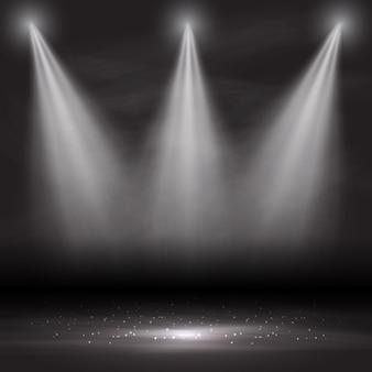 Três holofotes brilhando em um quarto vazio