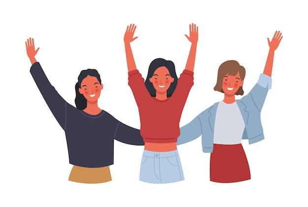 Três jovens mulheres sorrindo e levantando as mãos.