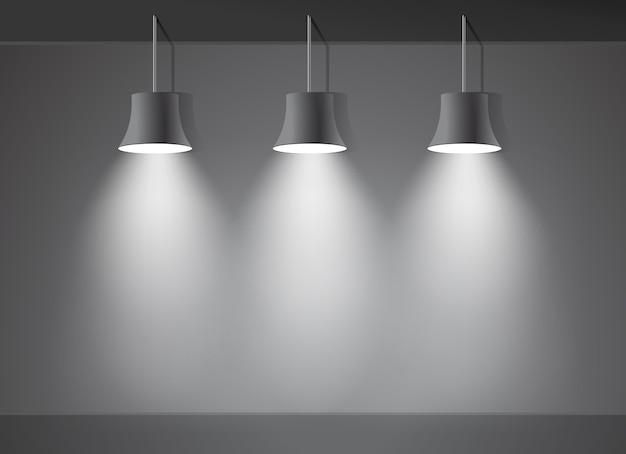 Três lâmpadas em tons de cinza