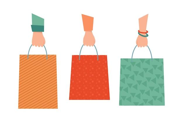 Três mãos e três bolsas. compras. sacos de presente. ilustração em desenho animado e estilo plano