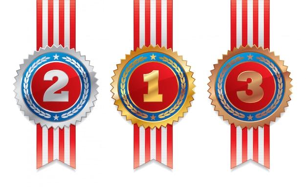 Três medalhas - ouro, prata e bronze com fita listrada.