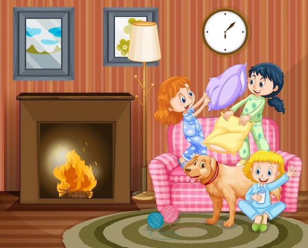 Três meninas e cachorro na sala de estar