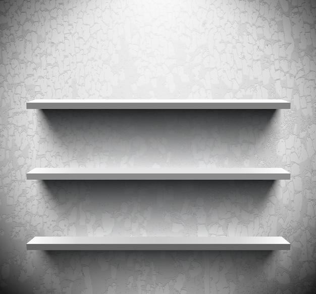 Três prateleiras iluminadas na parede rachada