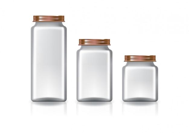 Três tamanhos do frasco quadrado desobstruído em branco com a tampa de cobre do parafuso.