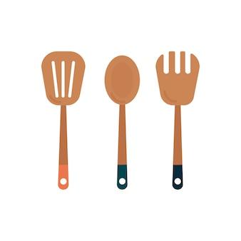 Três utensílios de cozinha de madeira