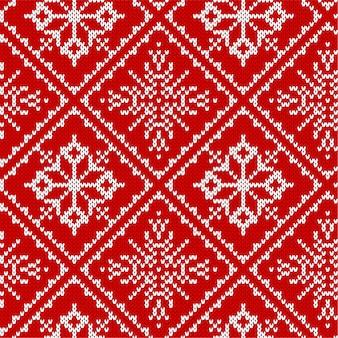 Tricô de natal sem costura padrão com flocos de neve.