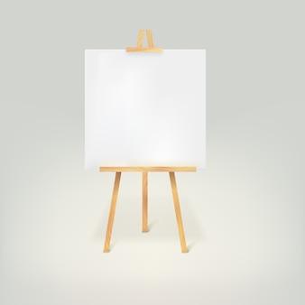 Tripé de madeira com uma folha de papel branca