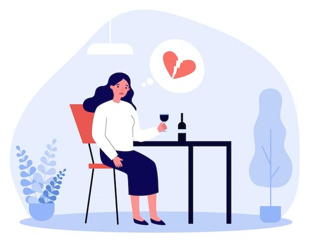 Triste mulher com coração partido, bebendo vinho