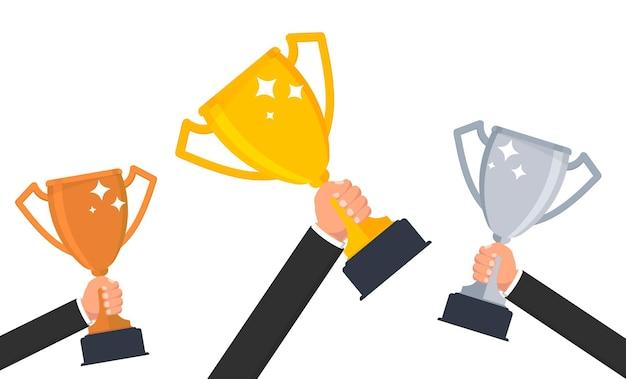 Troféu de ouro mão segurando a taça dos vencedores um símbolo de sucesso, vitória do campeonato