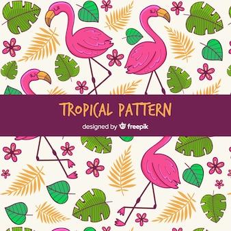 Tropical de fundo com flores, folhas e flamingos