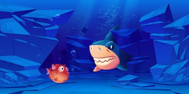 Tubarão e peixes-balão no fundo do mar ou oceano com rochas ao redor.
