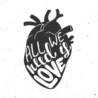 Tudo o que precisamos é amor no coração anatômico preto