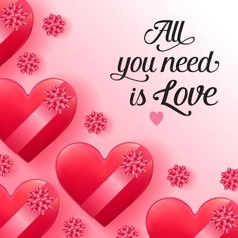 Tudo que você precisa é de amor lettering com caixas em forma de coração