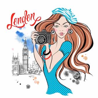 Turista de garota com uma câmera em londres