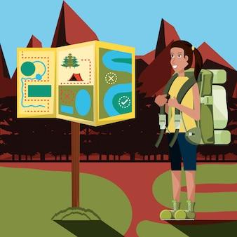 Turista de mulher na zona de camping e mapa