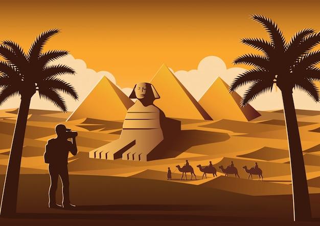 Turista tirar foto do famoso lugar chamado pirâmide