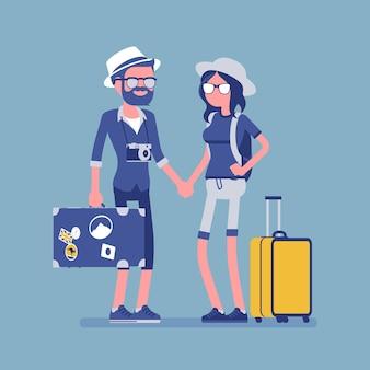Turistas em traje de viagem com bagagem e malas