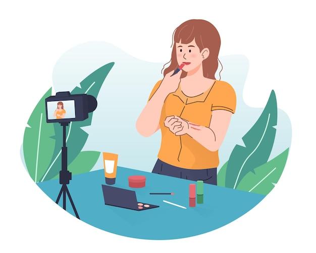 Tutorial de maquiagem de gravação de vlogger feminina usando a câmera