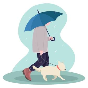 Um adolescente corre no meio da estação das chuvas com um cão de estimação