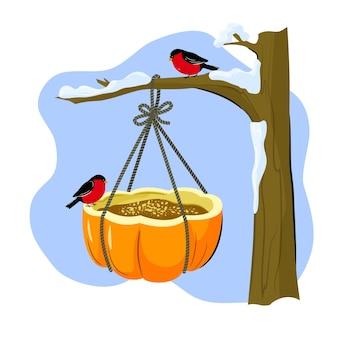 Um alimentador de pássaros de uma abóbora. artesanato de inverno com as próprias mãos com as crianças.