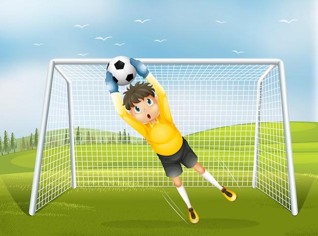 Um apanhador de futebol em um uniforme amarelo