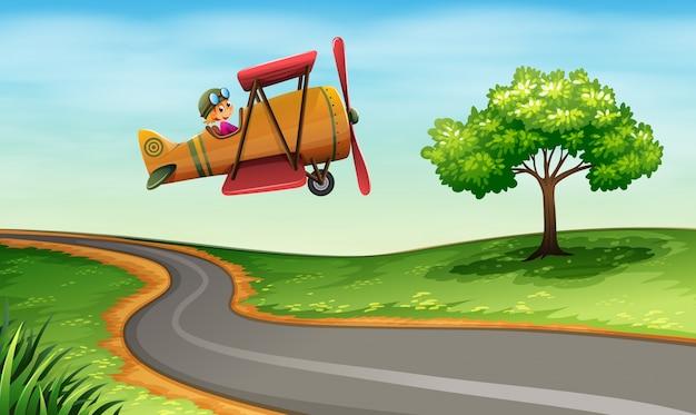 Um avião acima da estrada sinuosa