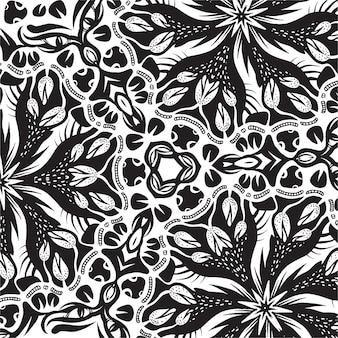 Um azulejo quadrado com elementos florais, desenho preto e branco