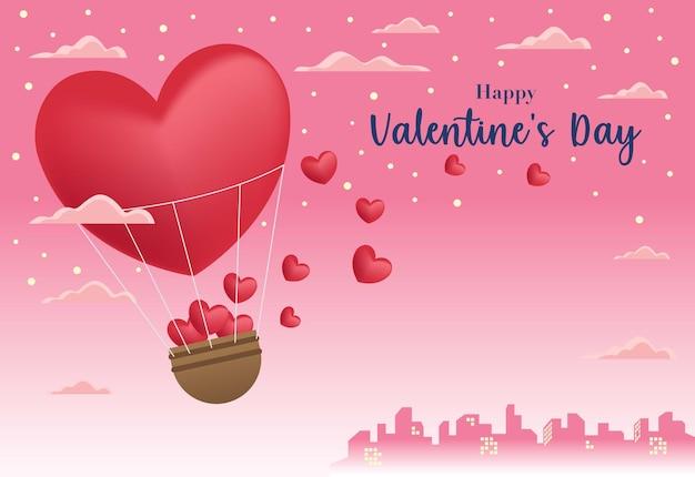 Um balão de ar quente em forma de coração carregando um monte de pequenos corações em uma cesta com um plano de fundo da cidade e um céu rosa